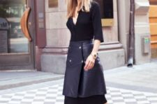 With black dress and leather skirt