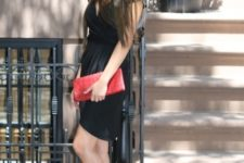 With black dress and red clutch