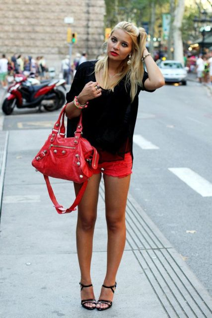 With black loose shirt, black sandals and red bag