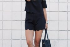 With black scallop shirt, metallic shoes and black bag