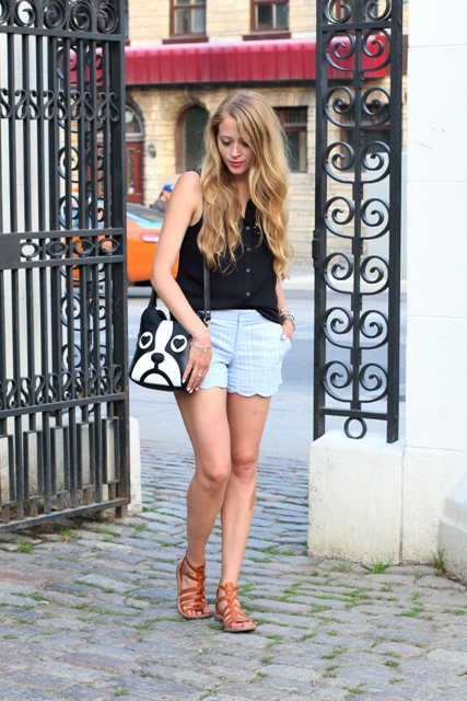 With black shirt, brown sandals and funny bag