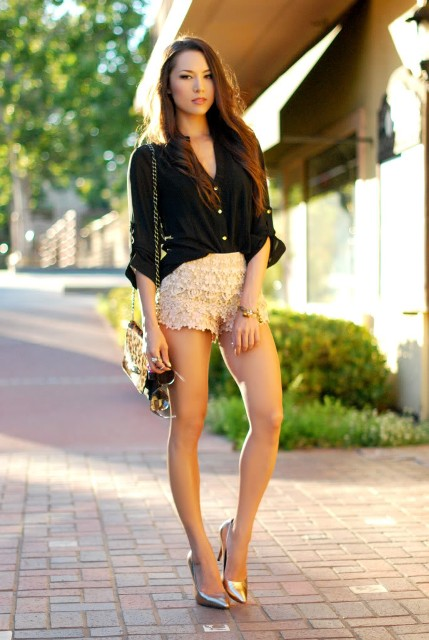 With black shirt, chain strap bag and metallic pumps