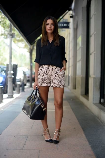 With black shirt, heels and black big bag