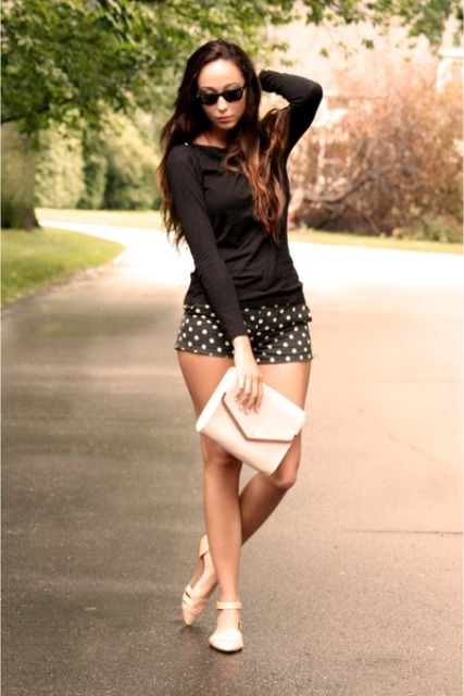 With black shirt, white shoes and white clutch