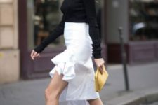 With black shirt, white skirt and yellow clutch