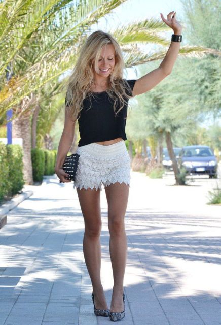 With black t-shirt, printed pumps and embellished clutch
