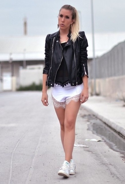 With black top, black leather jacket and white shoes