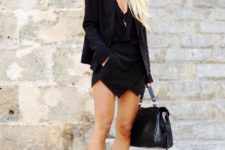 With black top, blazer, bag and cutout shoes