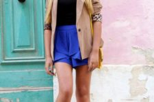 With black top, camel blazer, yellow bag and printed flats