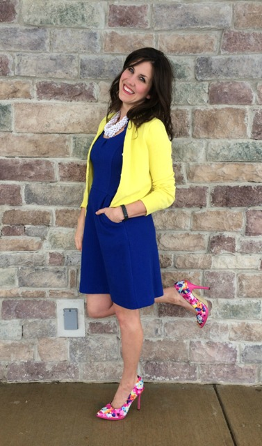 With blue dress and yellow jacket