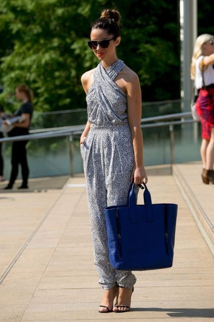 With blue tote and thin strap sandals