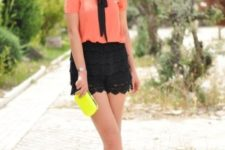 With bright color blouse, yellow mini clutch and pink shoes