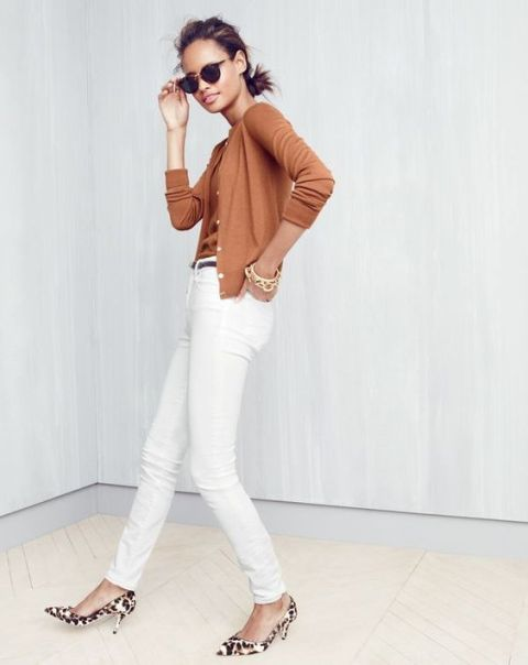 With brown shirt and white pants