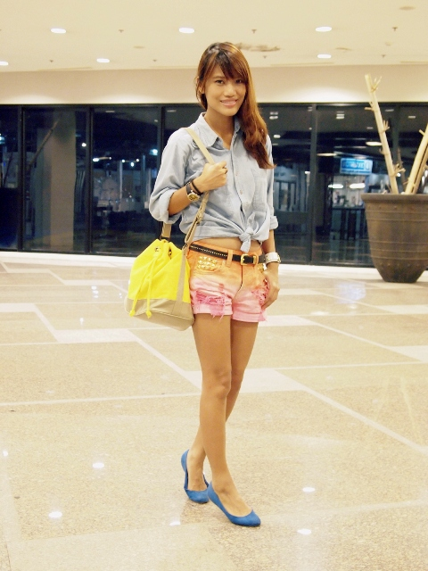 With button down shirt, beige and yellow bag and blue flats