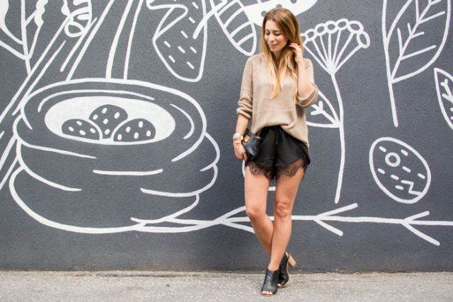 With camel loose shirt, black clutch and black cutout boots