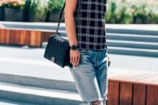 With checked top, cuffed jeans and black bag