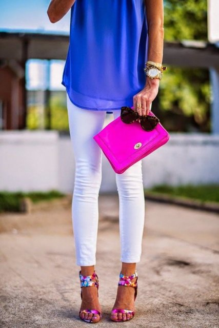 With cobalt blue top, white pants and hot pink clutch