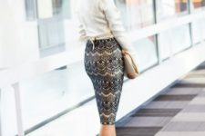 With cream shirt, printed pencil skirt and clutch