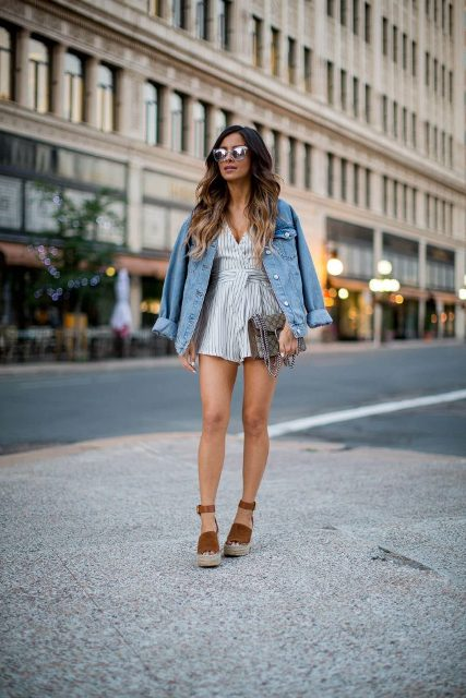 With denim jacket, platform sandals and printed clutch