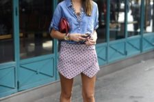 With denim shirt, brown sandals and marsala clutch