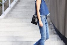 With denim top, jeans and black bag