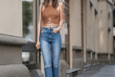 With distressed jeans and platform shoes