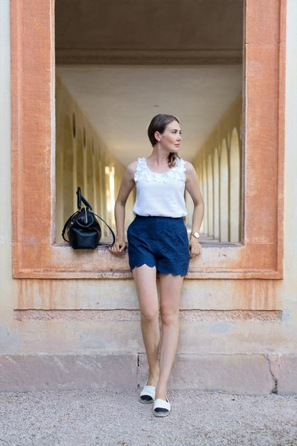 With feminine top, espadrilles and black bag