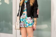 With floral crop top and shorts, leather jacket and beige bag