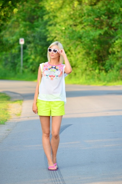 With floral shirt and pink slide sandals
