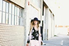 With floral shirt, black hat, pale pink scarf and flats