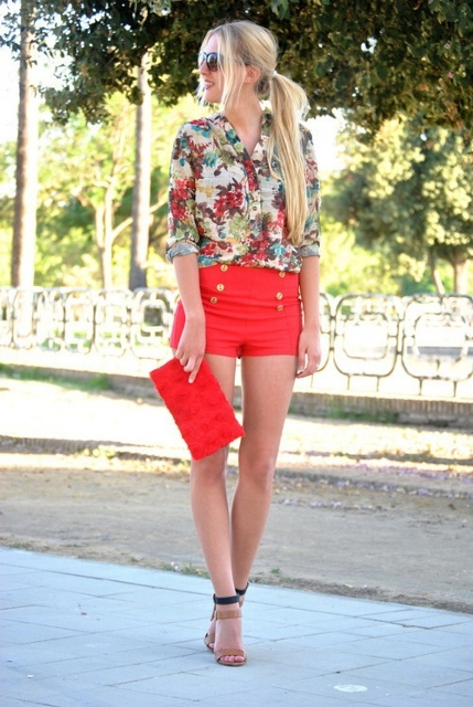 With floral shirt, orange clutch and leather sandals