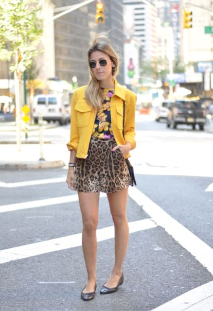 With floral shirt, yellow blazer and flats
