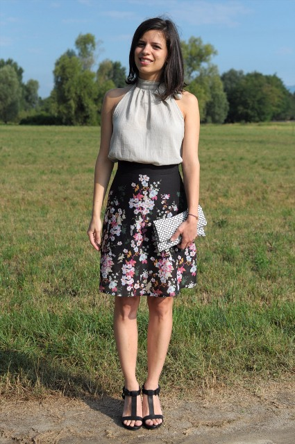 With floral skirt, printed clutch and black sandals