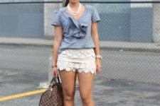 With gray shirt, beige shoes and printed bag