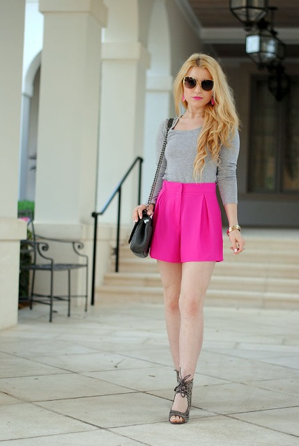 With gray shirt, black chain strap bag and unique shoes
