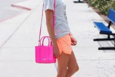 With gray t-shirt, hot pink bag and sneakers