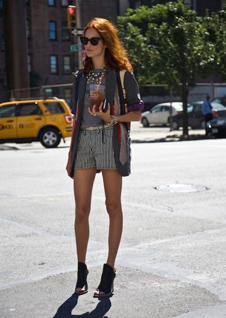 With gray t-shirt, long blazer and cutout boots