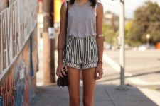 With gray top, black flats and black crossbody bag