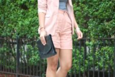With gray top, pale pink blazer, two color sandals and black clutch