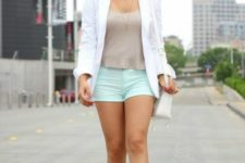 With gray top, white blazer and beige shoes