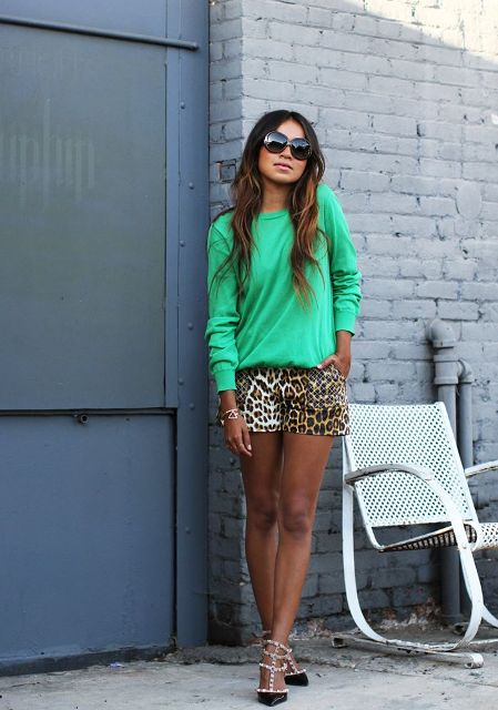 With green shirt and heels