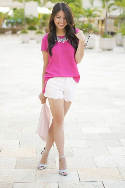 With hot pink blouse, white sandals and clutch