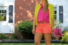 With hot pink shirt, yellow jacket and two color sandals