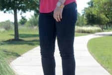 With hot pink top, jeans and neon clutch