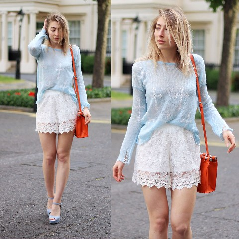 With light blue loose shirt, red bag and blue shoes