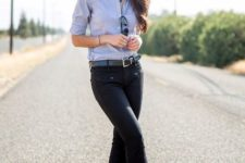 With light blue shirt and black pants