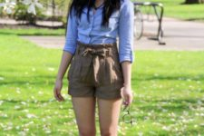 With light blue shirt and brown flats