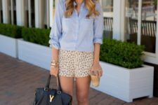 With light blue shirt, hat and black leather bag