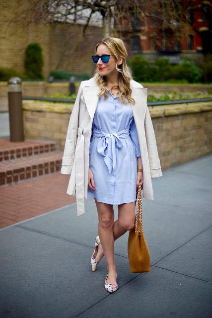 With light blue shirtdress, cream light coat and brown bag