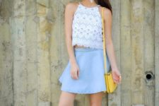 With light blue skirt, yellow bag and sneakers